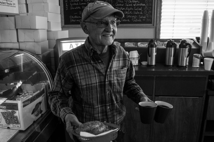 This is the face of a donut owner as he proudly makes his way back to the table with his purchase. This gentleman came with twelve people specifically for National Donut Day.