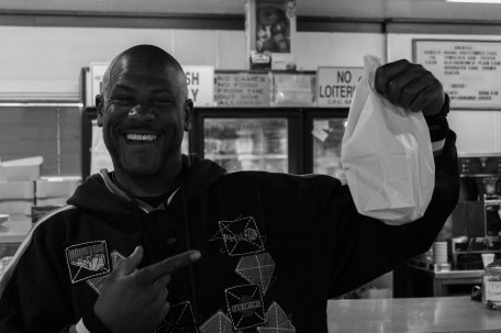 One of the many awesome people I met on this National Day of the Donut, Frederick Leray Manning Jr. is leaving the Donut Wheel with a bag of donuts and a big smile. I bet that bag is empty by now.